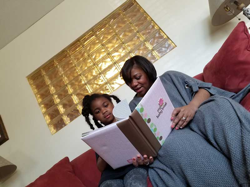 Tameika-reading-with-daughter