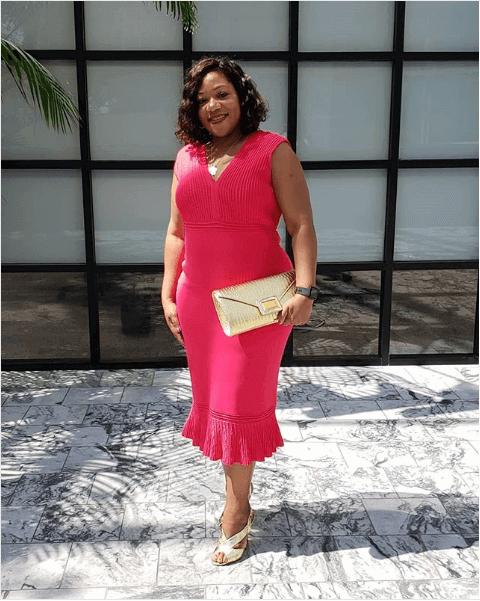 Tameika Isaac Devine in NY and Company sheath dress